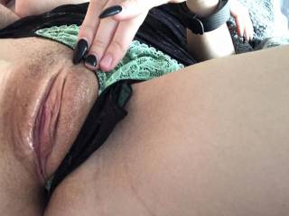 Panties pulled to the side and pussy dripping wet, ready for a dick or two