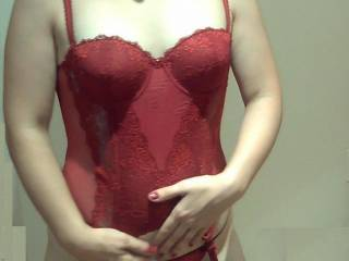 My girl is so fucking hot in her red lingerie, isn\'t she?
