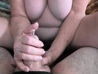 """Giving him a hand job while using his new X-MAS gift, a 8"""" long glass penis plug. Put it into fridge and let it get nice and cold, he loved the temperature difference. Would you like to try this?"""