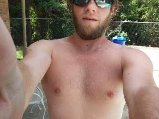 Hanging around my pool showing off this body with my scruffy look on point. May shave though... Maybe even shave my head and face and get everthing smooth 😉