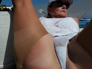 Warm8ng my pussy bulge in the sun..