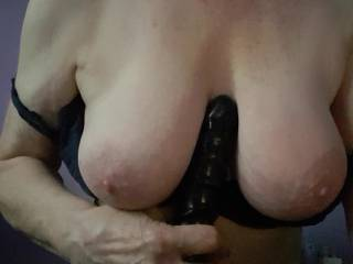 Busty mature Irene plays with her dildo on her big tits
