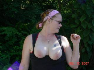 I love this picture.  Your wife has beautiful tits,  You're a lucky guy.