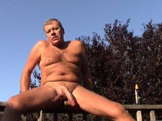 I am out on my deck and get my ass on the railing  about to jerk off  my cock, although a stiff dick is always fun to see a man's hanging semi hard cock can tell a story too yes?