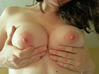 Those nipples are just begging for me to kiss, suck and nibble on them!  I'll get them long and hard and then tug on them with my teeth....