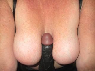 Big black dildo between my tits.