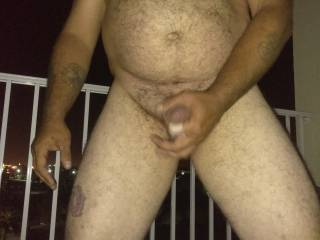 It is hot outside so I got naked and then went out on my balcony and decided to jerk-off anyone else like to be naked Outside where you can be seen