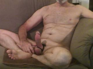 mature guy masturbating my big dick with my balls tied and my large butt plug up my ass while showing you my sexy feet