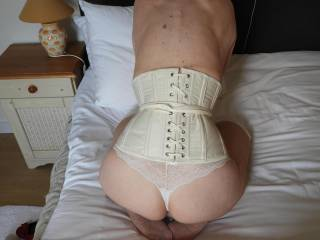 My wife loves wearing a corset to enhance her small waist.