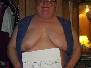 Your vest looks fine, shows off those big gorgeous tits, they look awesome