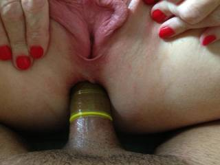 Her 'friend' fucking her ass after fucking her pussy for 30 minutes. Look how swollen her lips are from the pounding...