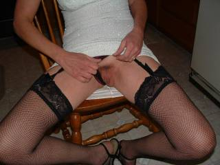 mmm, love those legs of hers in those stockings and sexy heels!!!
