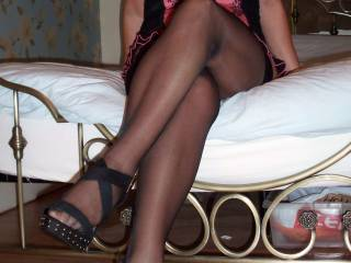 There is nothing sexier than a beautiful woman with amazing legs and feet in stockings and heels OMG...unbelievably hot!!!