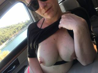 Flashing my titties in the car after a day at the lake. Do you think anybody saw them?