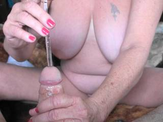 1 of 4 photos showing me pushing  new sex toy, a glass rod into my boyfriends cock. It is about 9 inches long and about 8mm wide. In this photo I have pushed it in about a third of the length, he just loves the feel of it, would you like to try this?