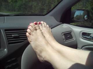 She loves to show off those pretty feet trucker, you\'d like to see too?