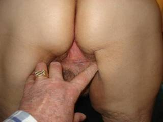 Mature pussy being spread open