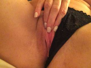 She pulled her black lace panties to the side and played with her lovely wet pussy for me