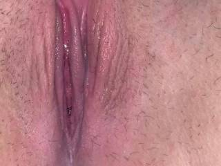 Playing with her wet creamy pussy after I got done fucking her