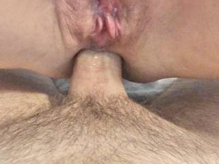 My ass is filled but I would love a woman or man to be licking my wet pussy at the same time!