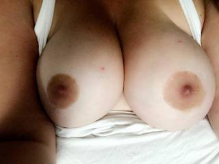 Do you like what you see? Want to see more? My husband loves to play with my big tits and make my nipples rock hard by sucking on them!