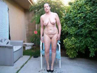 nude wife posing outside