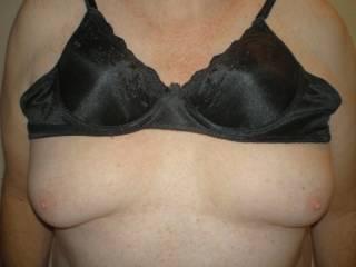 Lifting her bra.