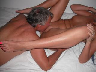 Our swinger friend eats out my pussy, when he came around again for another threesome.