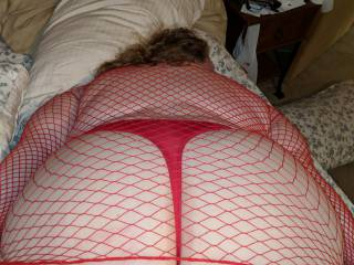 My wench looking and feeling sexy in her fishnet and thong. Game on.