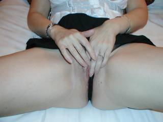 I want to see her beautiful fingers stroke her pussy lips then spread them and stroke her clit for me while I stroke my cock and cum on her clit
