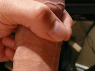 Stroking my hard cock.