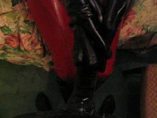 Anna milking a rubber covered cock in her shiny latex gloves.