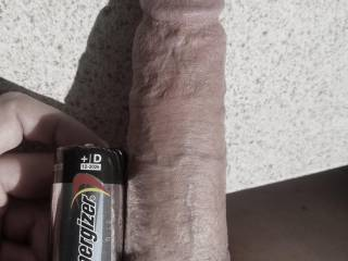 At 6.5 inches long when fully flaccid, I still dwarf a D battery. This shot was for a future lover who wanted me to compare mine to her cuck boyfriend's tiny stub...he isn't even as long as the battery (2.25 long).