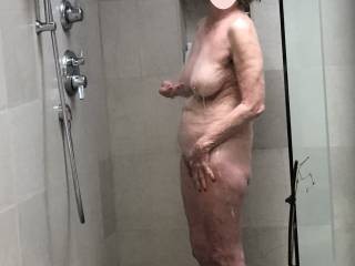 I found another photo of my sexy wife showering. I hope her fans enjoy it.