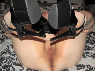 My lovely BBW wife on her back showing off her smooth chubby mound in her favourite heels - you mind if she leaves them on while you\'re balls deep inside her?