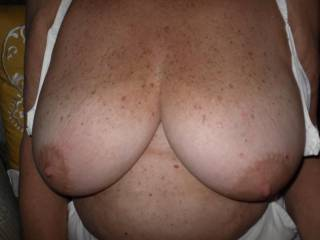 Taking off my bra and exposing my big natural mature tits.  How about a feast?