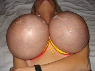 god i would love to drain these young, full balls all over those huge tits... i love how tight and firm big, soft tits get when bound. dying to slide my cock between them