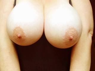 what a sexy pair of breasts, would love to lick and suck your sexy hard nipples then fuck your wet tits with my big thick shaved cock...