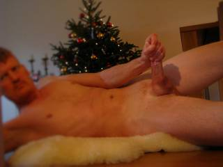 playing infront of the tree...all oiled up...love it