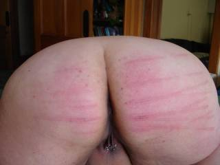 Oh god yes spank her ass hard as I shoved a bottle up her cunt. Mmmmmm