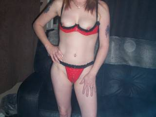a few of me in my red and black leather crotchless knickers and cupless bra hope you like....