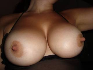 Yes! I love those big beautiful tits and huge nipples! They need a big load of cum dripping from them,I volunteer!