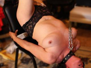 Awesome erotic pic of Suzi's hot body in chains, ready to suck a nice big cock while being having her body played with at the same time....