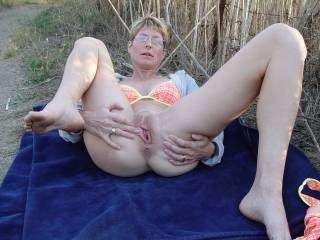 Wow I would like to be taking a walk in the meadow and cum across you both taking photos like that. My cock would be rock hard and in my hand. I would like to join her while you took photos of the action !...