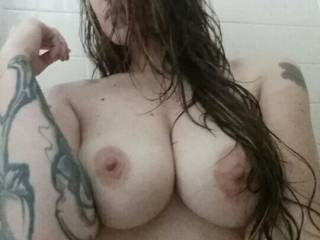 Wet hair clinging to my breasts makes for a seductive selfie in the shower. I need someone to take more with me. ;)