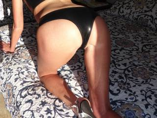 How's my ass in latex undies?.....enticing?.....