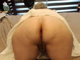 This married woman is in position. Which hole do you want to fill first as we make Hubby watch?