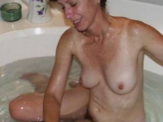 WoW! No way can that sexy lady be 52! She looks hot. Man, would I love to suck on her tits