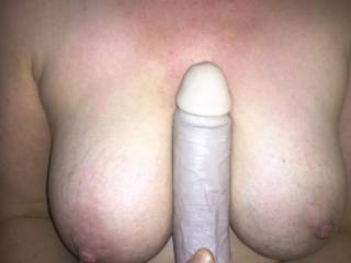 After using my big black dildo i like to rest it between my breasts while my husband fucks me stupid. I'm practicing till i get the real thing.