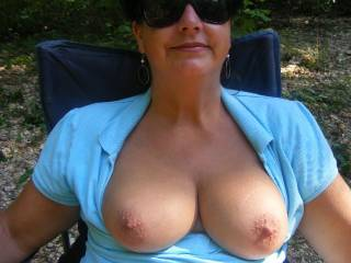 Put you up against a tree and give those tits a nice going over with my mouth then have you on your knees so my cock can side between them and into your open mouth